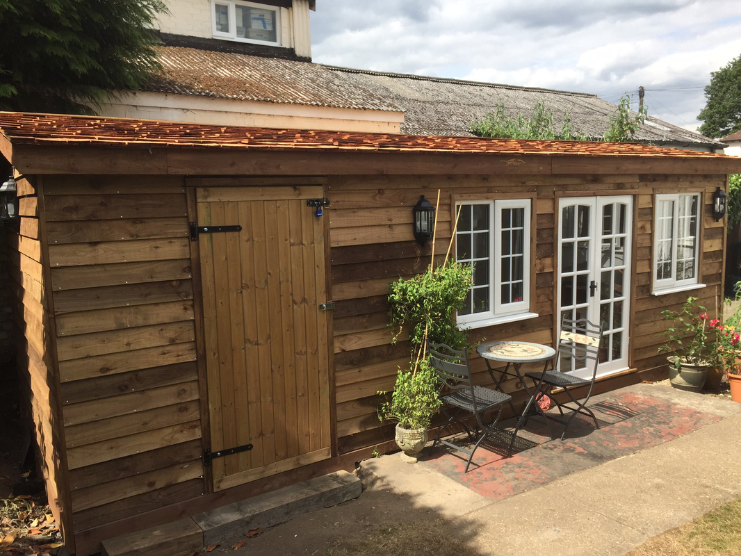 Addlestone bespoke garage looking cabin custom built for Build your own beach house